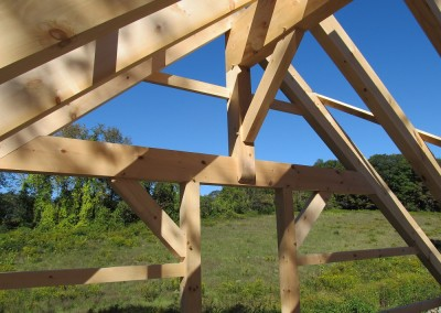 A nice detail on the second floor of this eastern white pine frame. This photo highlights how a center ridge timber system might be designed.