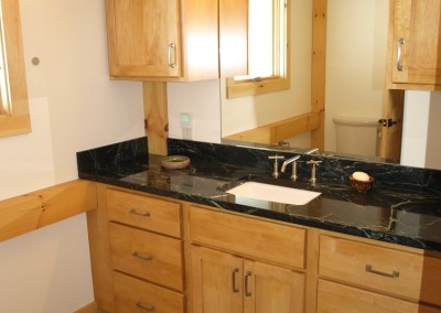 Black granite countertop is a nice contrast to the maple cabinetry.