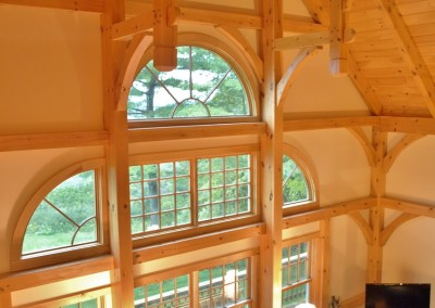 Circular windows are featured in this Wilmington Vt home