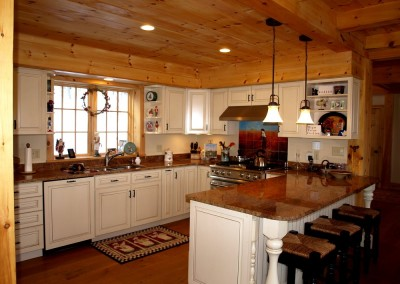Classic u-shaped kitchen with bar area for casual dining