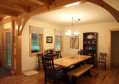 Conventoinally built dining room meets a timber frame