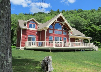Features such as arched and roundtop windows,large deck and entertainment area,and generous timber overhangs make this design a winner.