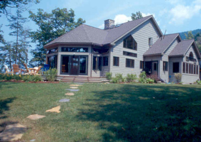 Lake George NY living at its best. A very private custom timber home is spectacularly situated on the east shore.