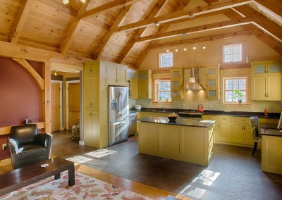 The collar-tied  pine trusses give a spacious feeling to this kitchen