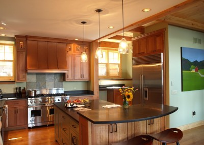 The copper range hood hints at French bistro