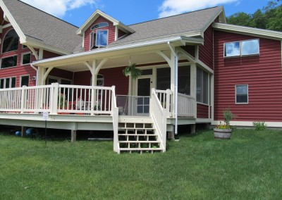 This large porch has plenty of room to relax and entertain