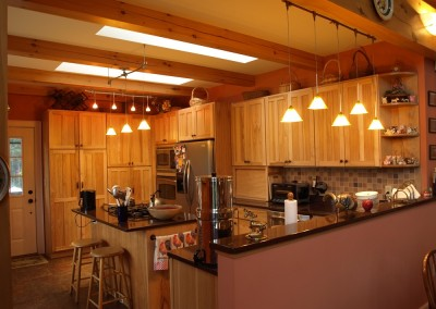 Two skylights and whimiscal pendants  give this kitchen plenty of light