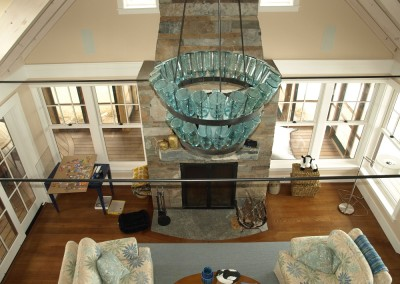 Unique light fixture and stone fireplace are featured here. Notice the powder coated metal rods we installed  as wall ties.