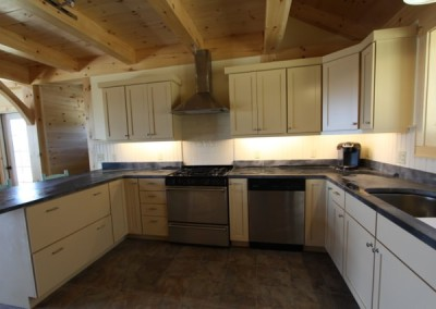 White cabinetry and soapstone countertops are off grid in Mt. Holly,Vt