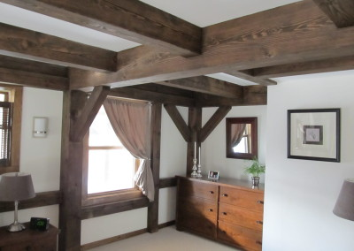 White walls and ceiling make the dark stained timber frame really well defined.