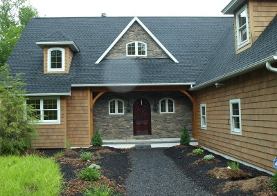 With a nice mix of stone and cedar shingles for siding, this Crogan NY home has a dramatic entry.