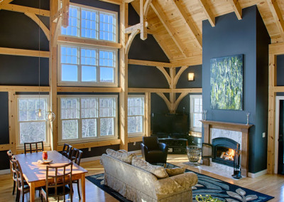 Timber frame great room with hammer beams and fireplace