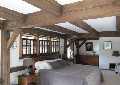 Dark stained timbers in bedroom