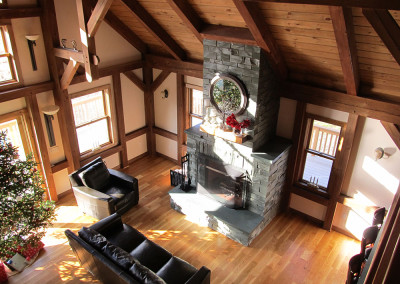 Dark stained timber frame with fireplace