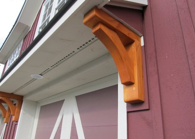 Decorative brackets frame in the garage door nicely