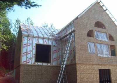 Exterior sheathing goes over the insulation packge