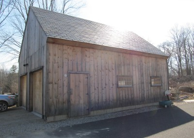 Finished barn has a slate roof and the owner wants to have the siding weather naturally.