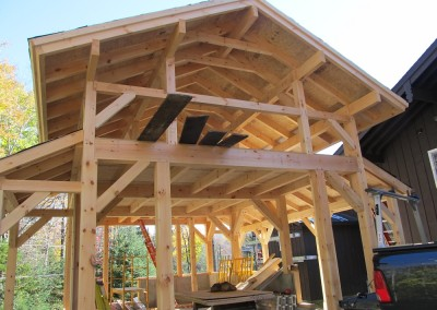 Matching this new barn to have the same ski house -alpine style look of their home was a priority for the owner.