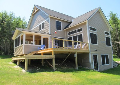 Multilevel decks, a sunroom off the dining room, and large living room are found in this St. George Vt home.
