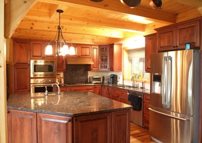 Stainless steel appliances, cherry cabinets, and dark granite combine for a classic look