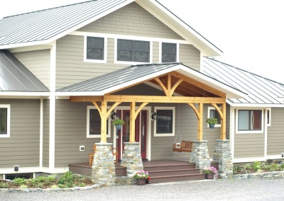 Stone pillars, Douglas fir frame, Trex decking, standing seam roof, Hardiplank siding all make for an awesome entry way.