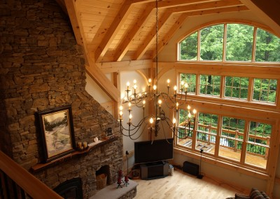 The fireplace is a focal point in addition to the beautiful eastern white pine timber frame