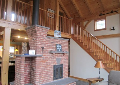 The homeowner of this Hubbarton Vt home opted for a brick fireplace in their cozy home