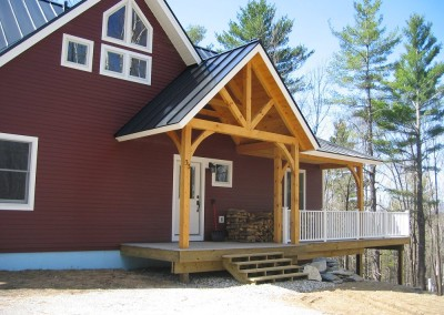 Weston Vt is the owners choice of location for their weekend getaway.  The timber porch gives a hint to what you'd find inside.